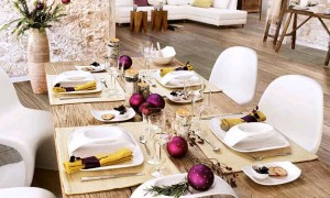 Christmas wooden table with purple balls and yellow napkins