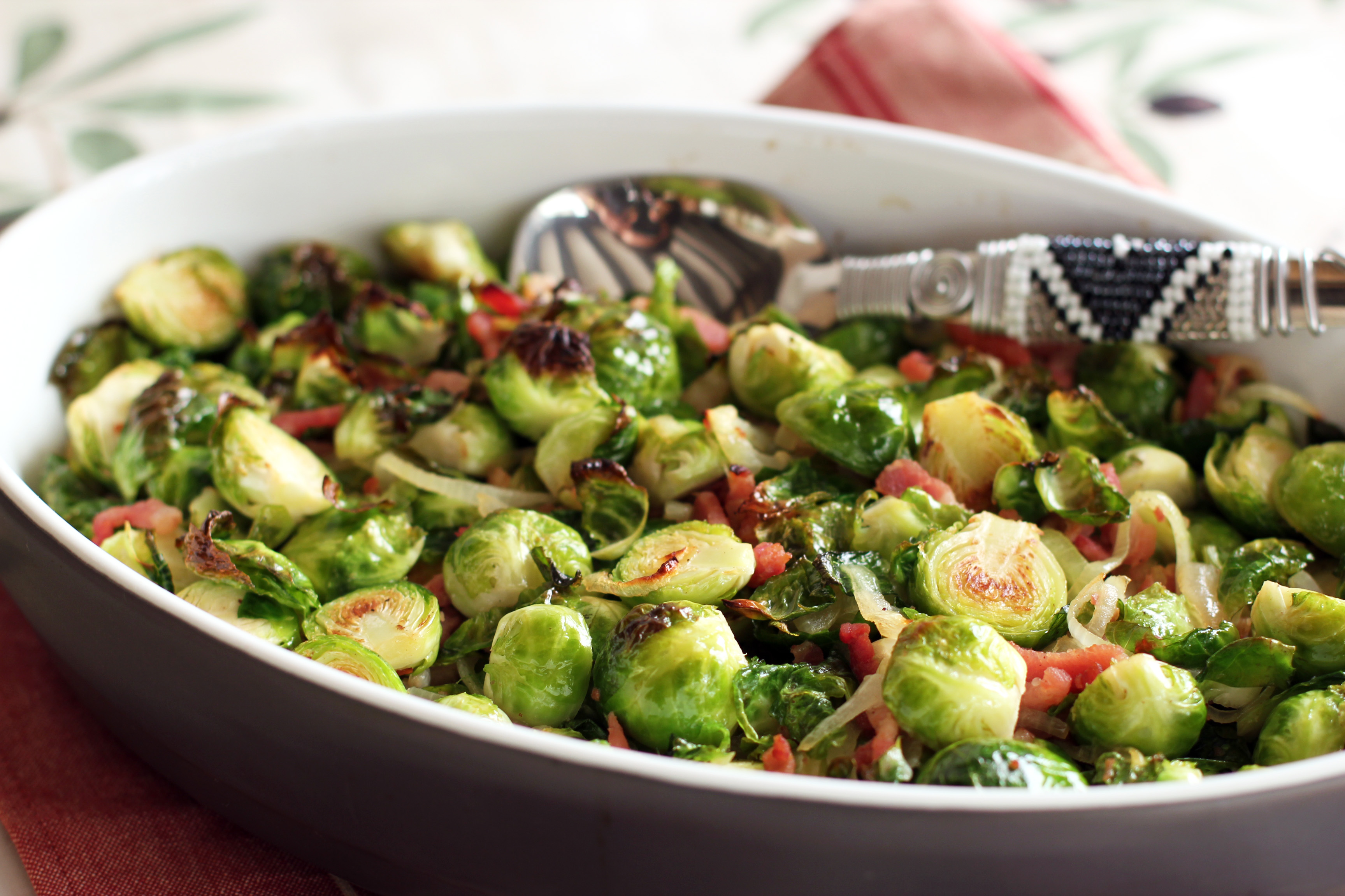 Green Brussels Sprouts in dish with spoon