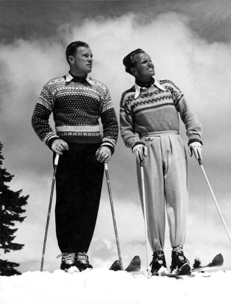black and white old picture of men skiing