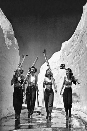 black and white vintage picture of women skiing