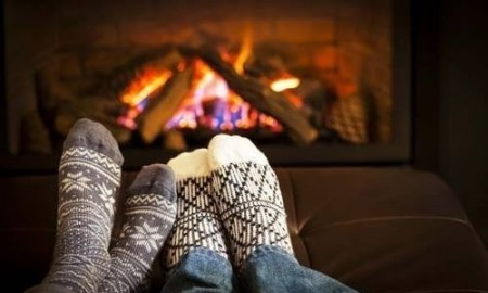 cosy socks in front of fireplace