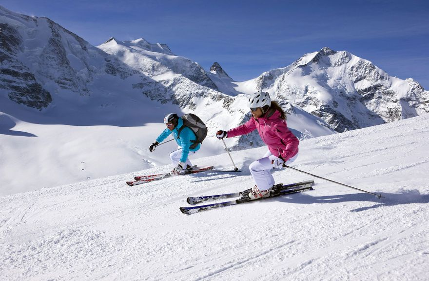 couple skiing in verbier