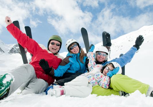 happy skiing family fun