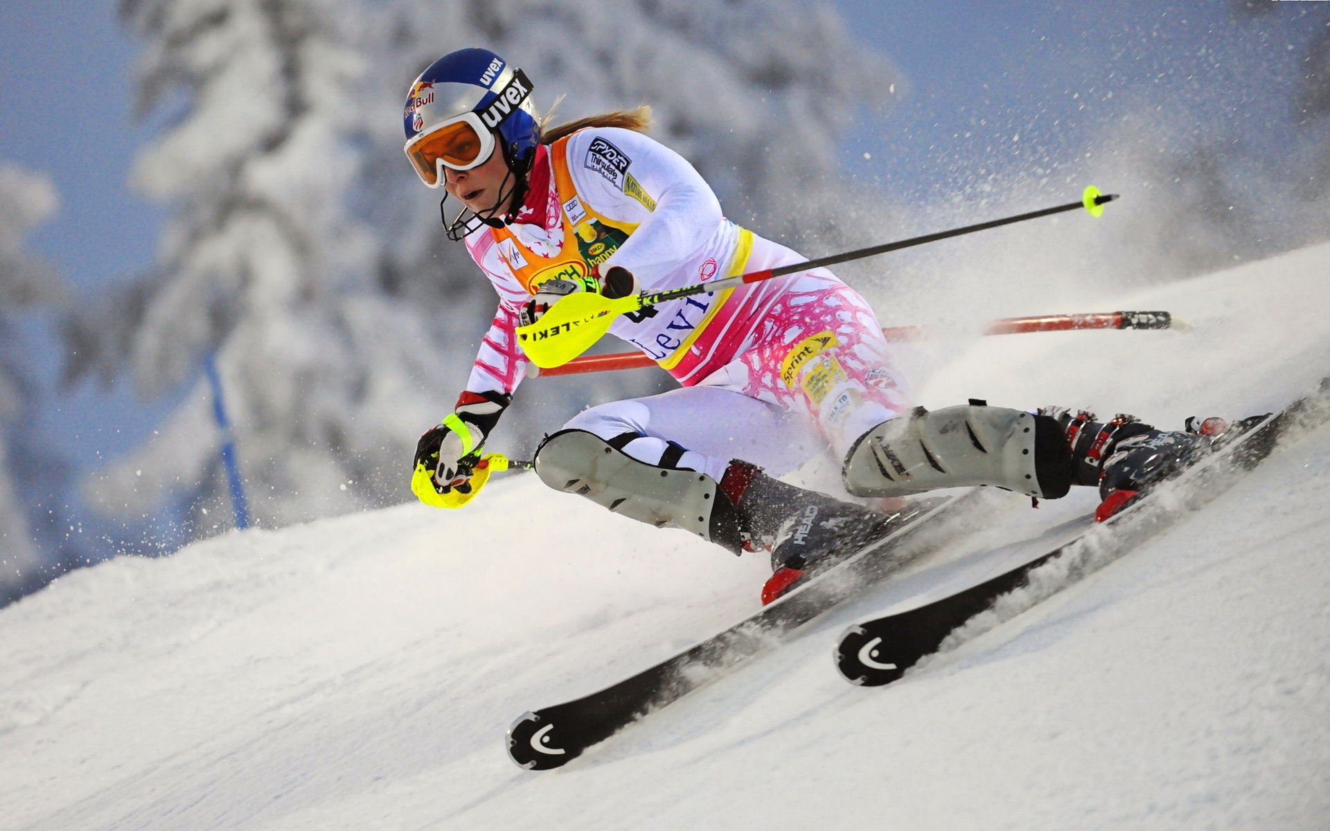 woman ski athlet racing with yellow gloves