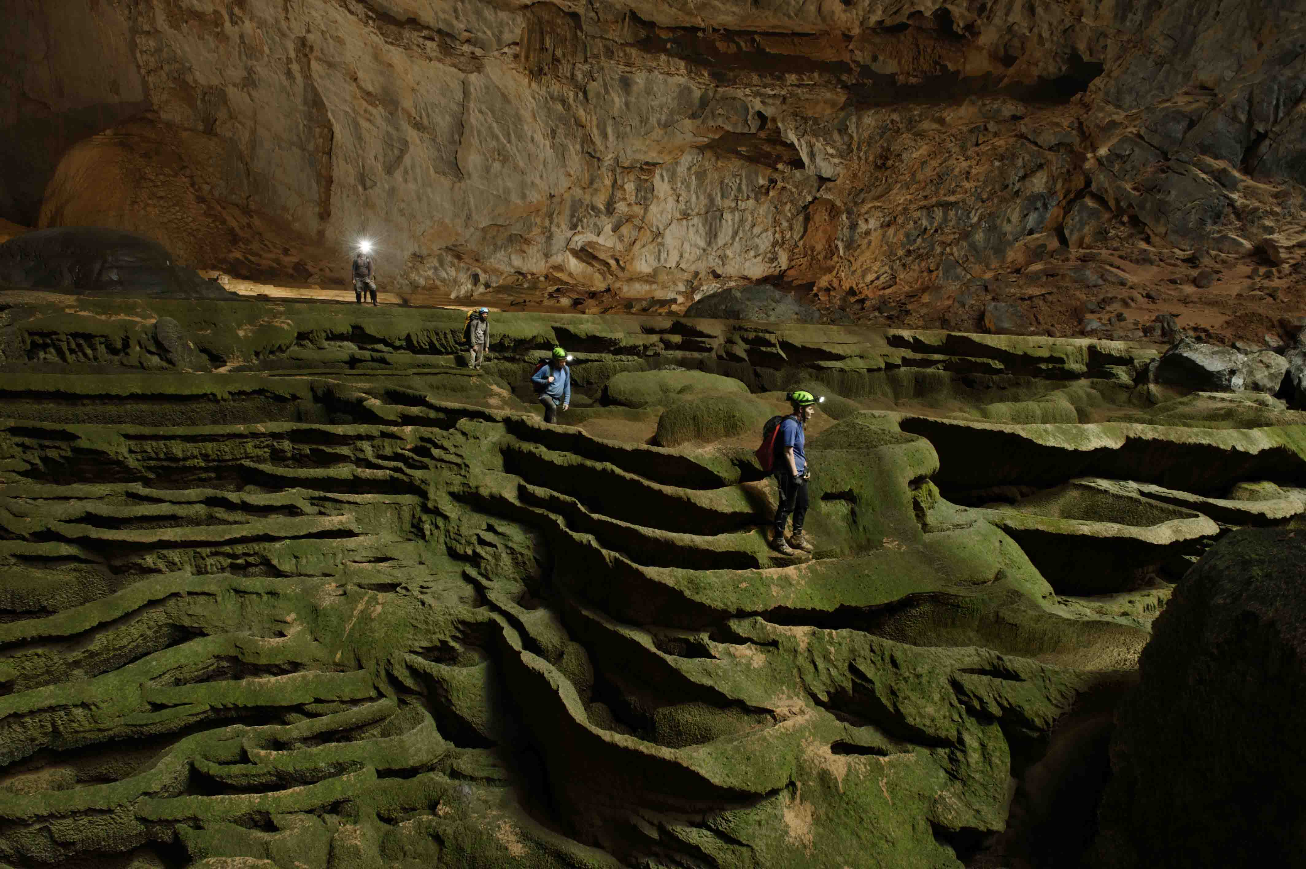 Hang Son Doong explorers navigate an algae-covered cavescape