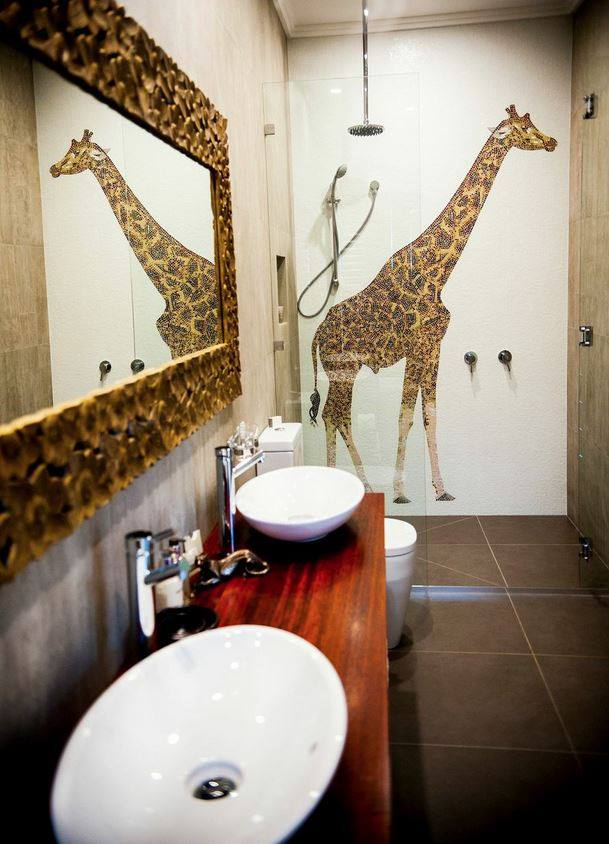 The Jamala Wildlife Lodge bathroom giraffe
