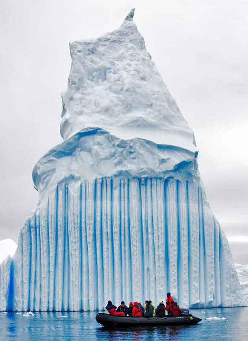 Huge iceberg with people