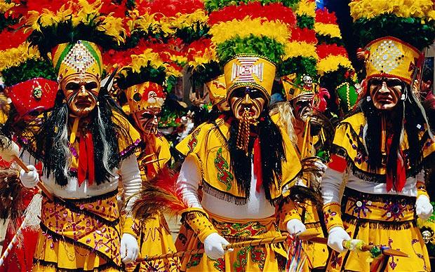 Carnival in Oruro men dressed in yellow