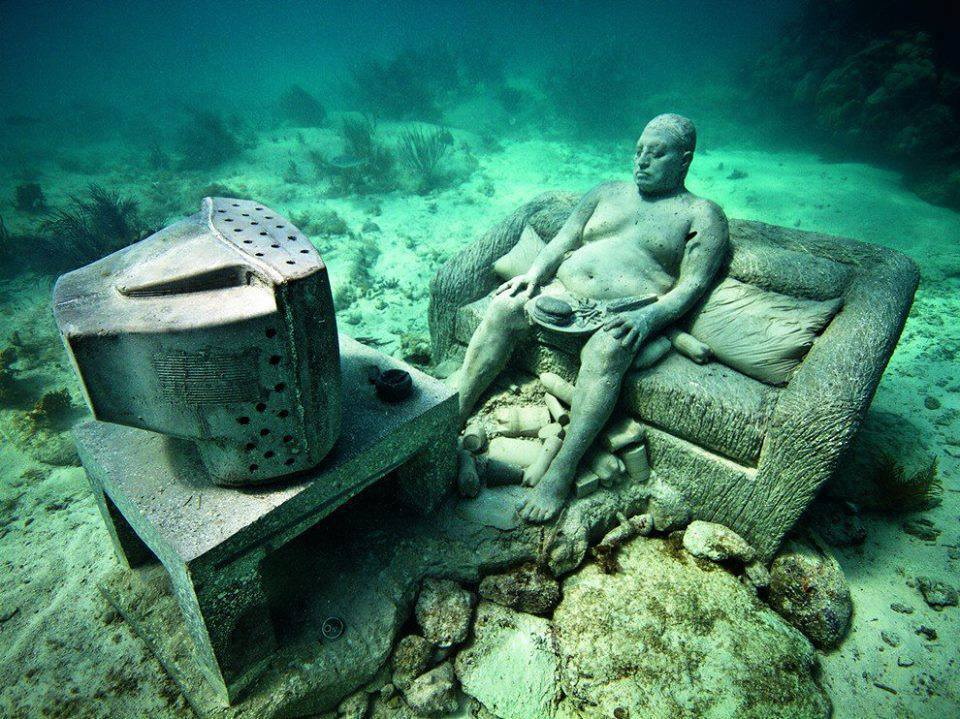 Underwater Museum in Cancun man watching tv sclupture