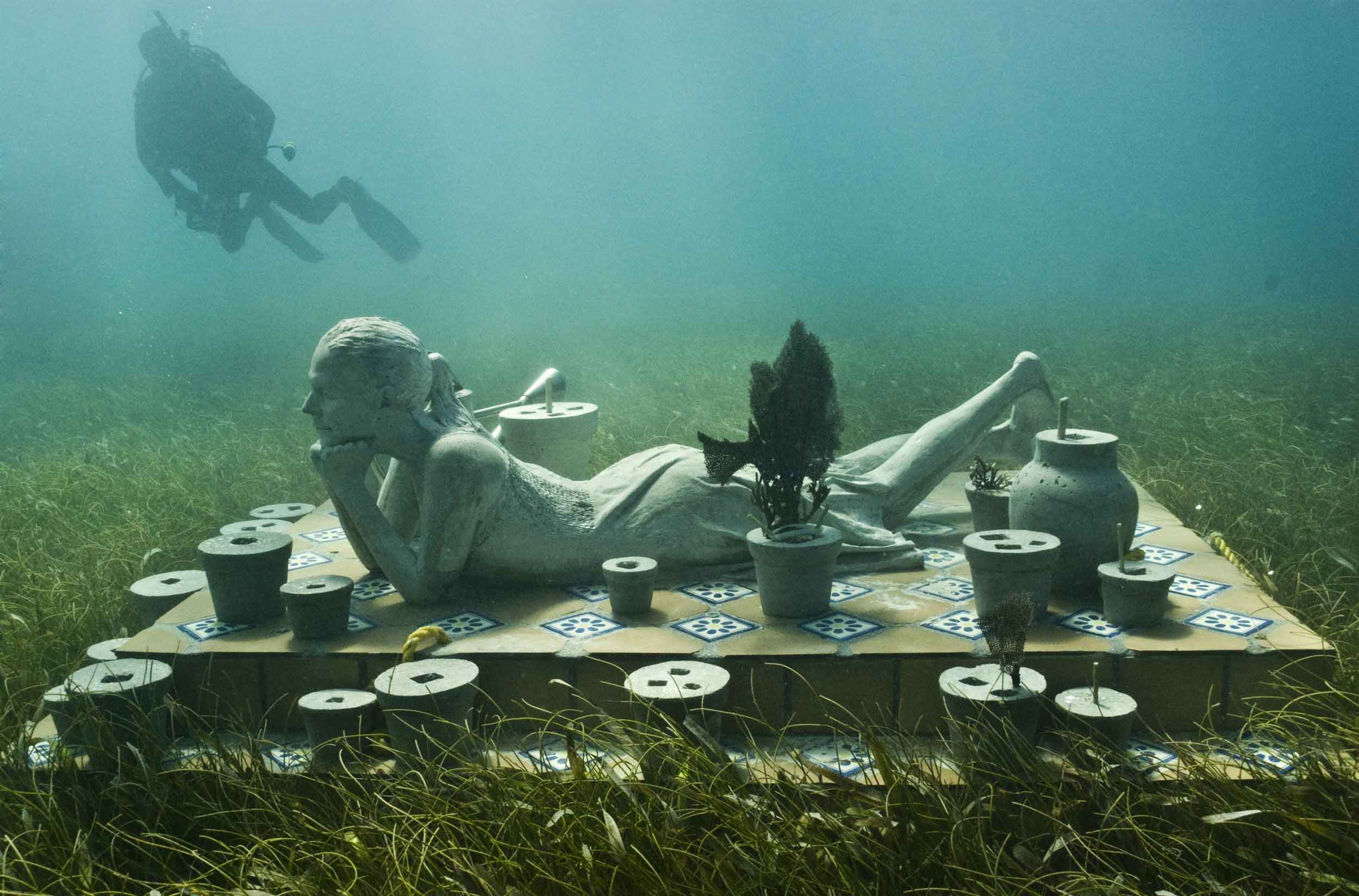 Underwater Museum in Cancun woman