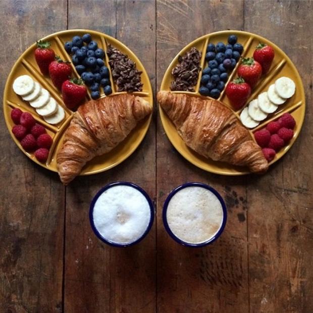 breakfast croissant coffee strawberries blackberries and nuts