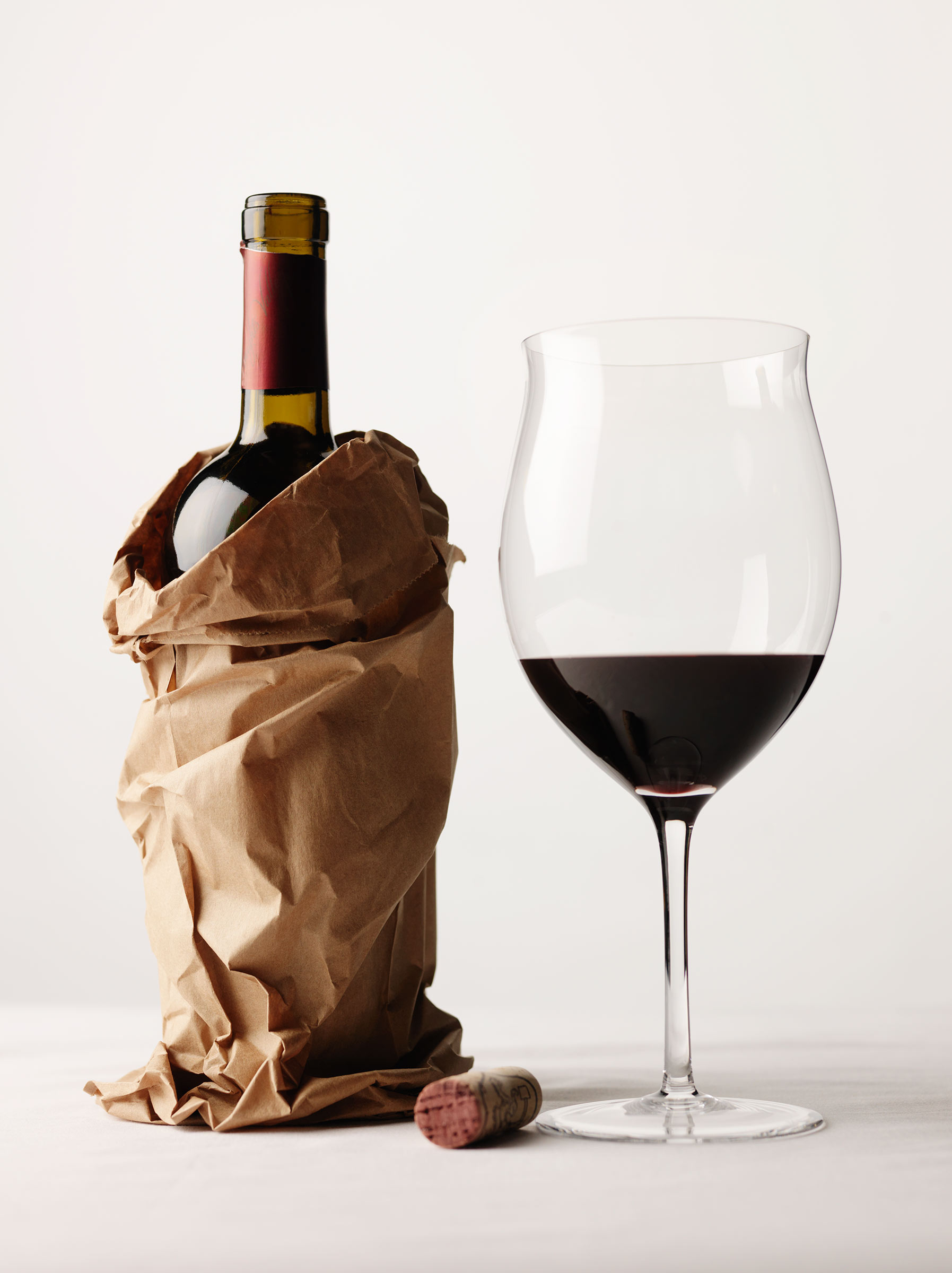 red wine in a bottle with a glass