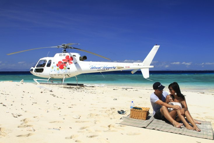 Plane in Fiji you can fly around the islands couple on the beach