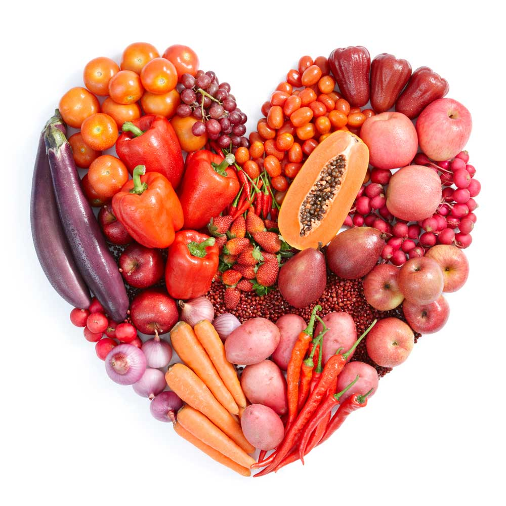 Heart-made-of-pink-and-red-vegetables-and-fruits