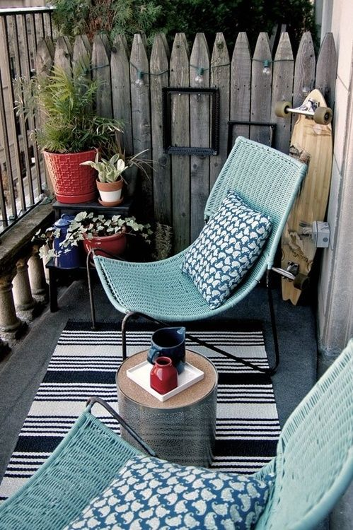 balcony with blue chairs