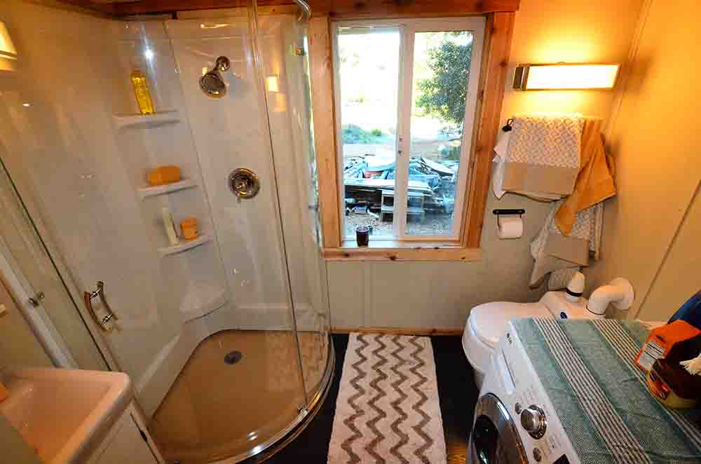 bathroom with shower cabine in tiny house
