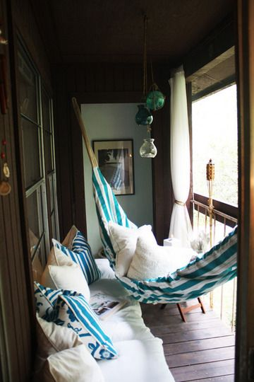 blue hammock with white pillows