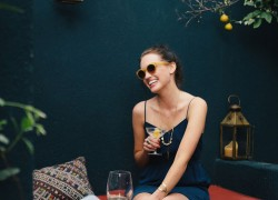 happy-woman-drinking-cocktail-outdoor