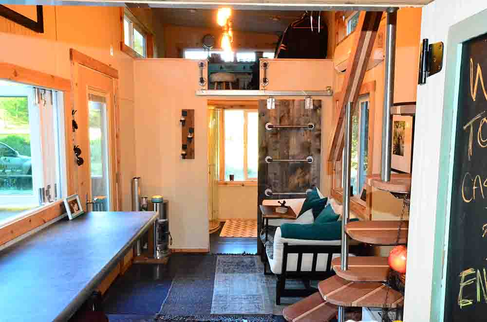 ladder in livingroom next to sofa in tiny house