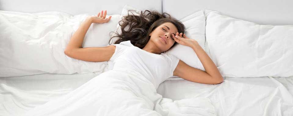 sleeping-beautiful-woman-on-white-sheets