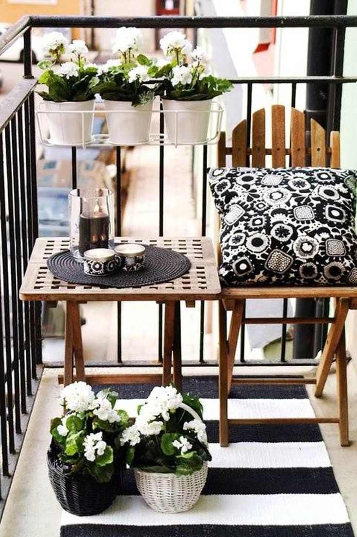 small balcony with black and white furnitures