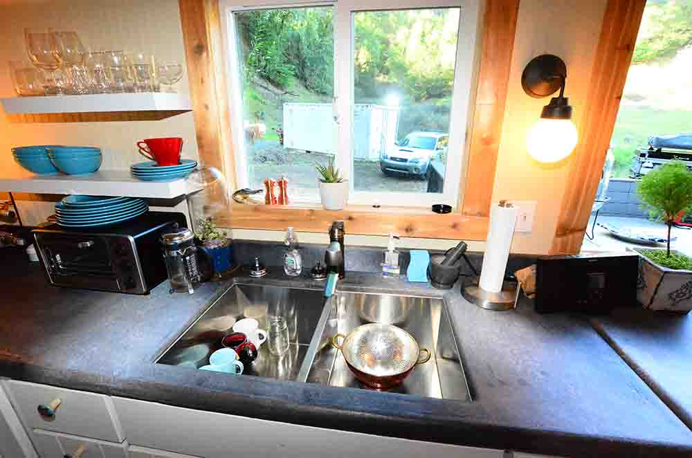 tiny house kitchen unwashed dishes