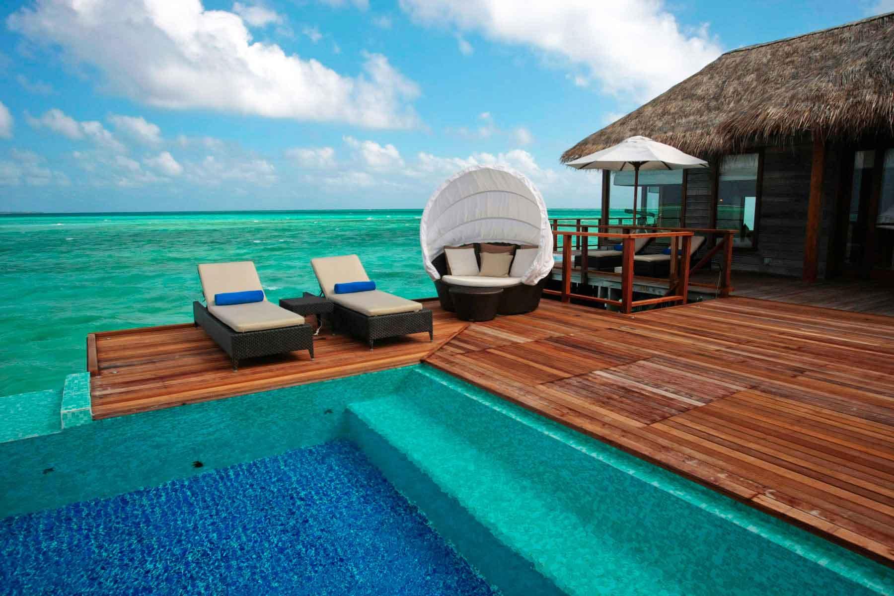 Hotel-Conrad-Rangali,-Maldives-outside-sunbeds