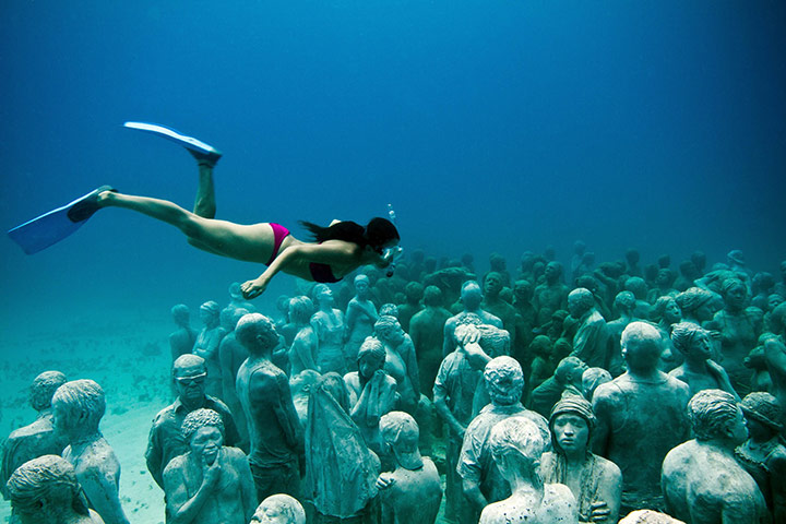 Underwater sculpture park, Grenada diving girl and many sculptures Jason deCaires Taylor