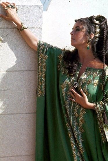 Elizabeth is a bejewelled beauty in a green kaftan in 1969 and Grecian hair. In Tangiers, Morocco.