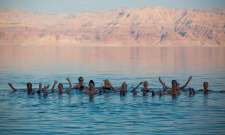 Deadsea-healing-powers,-people-swiming-in-dead-sea,-Israel