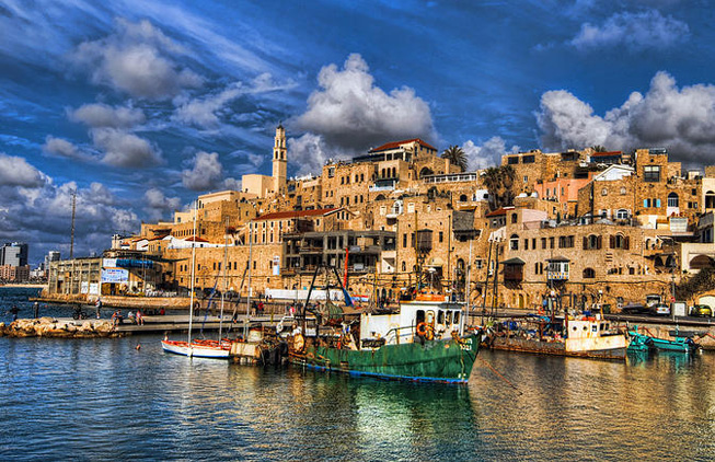 Jaffa Israel Flea market Tel Aviv harbour with green boat seaside beautiful clouds and landscape