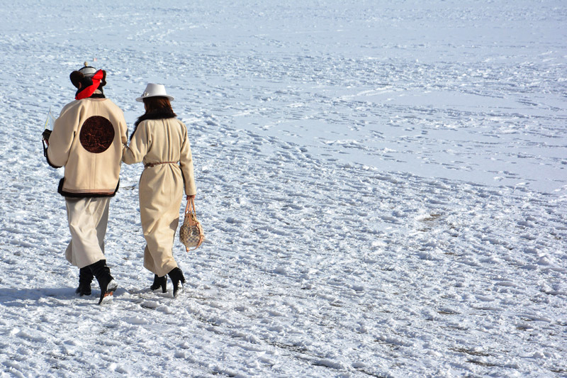 Ulan bator, Mongolia wintertime, a couple walking on the snow, The Coldest Places in the World