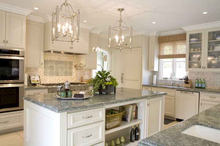 3-costa-esmeralda-cooking-island-and-cabinets-in-white-countertops-made-of-granite