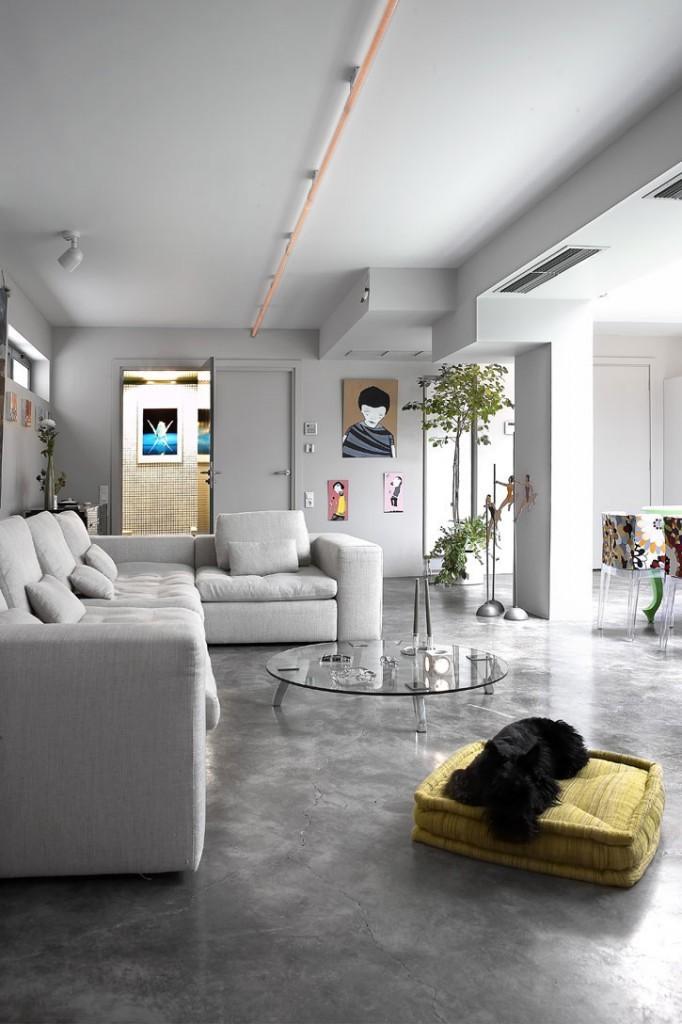 concrete-floor-corner-sofa-lounge-renovation-transformation-of-the-garage