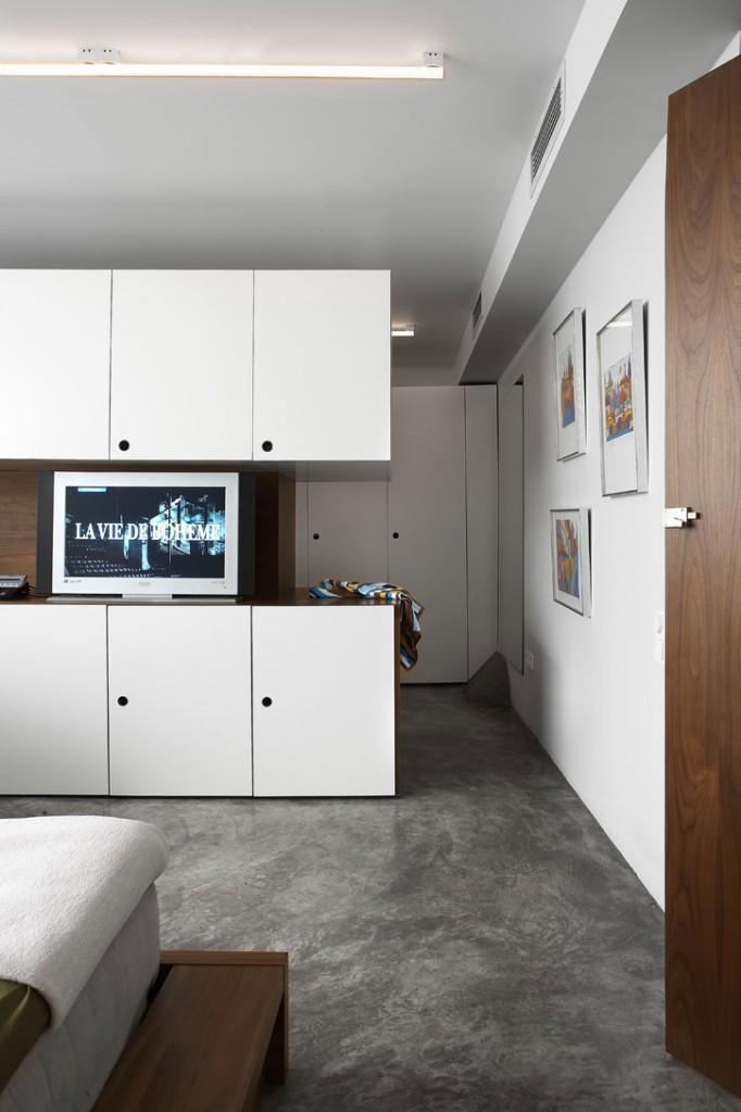 concrete-floor-wood-cabinets-living-room-transformation-of-garage