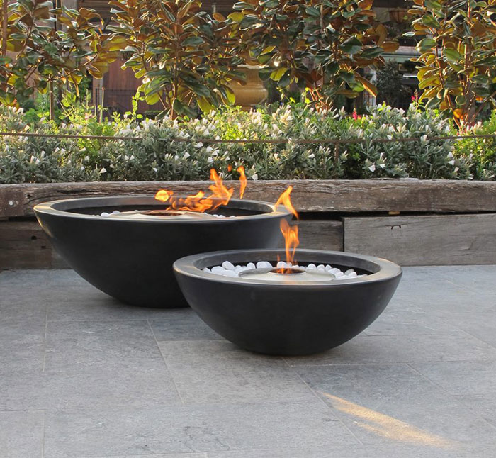 garden-outdoor-fireplace-stones-hozl-plants-shrubs-around-decoration-from-concrete
