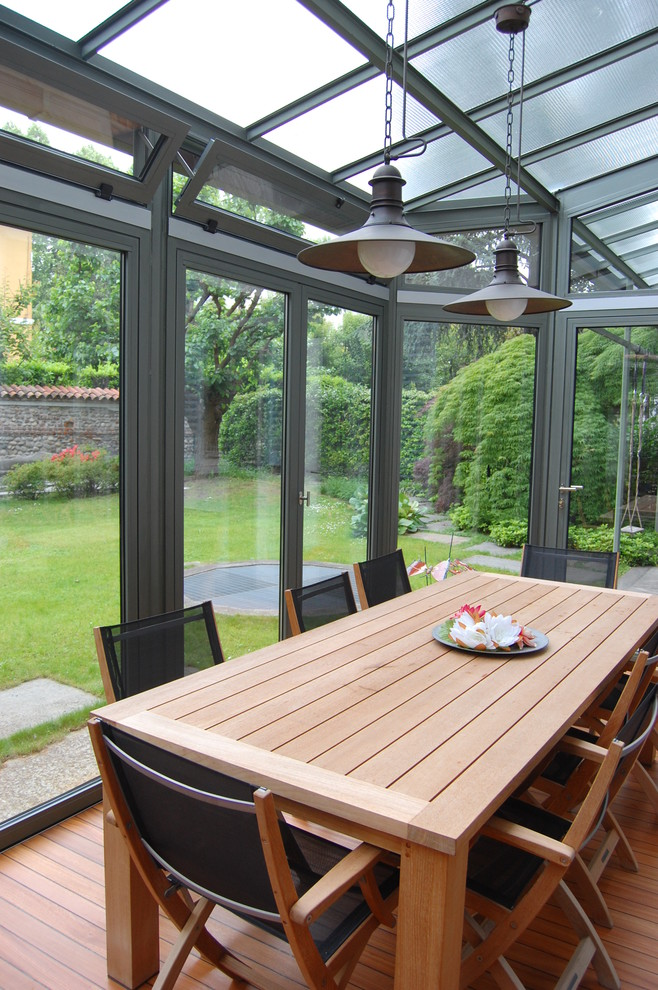glass-veranda-with-wood-furniture-design-of-the-veranda