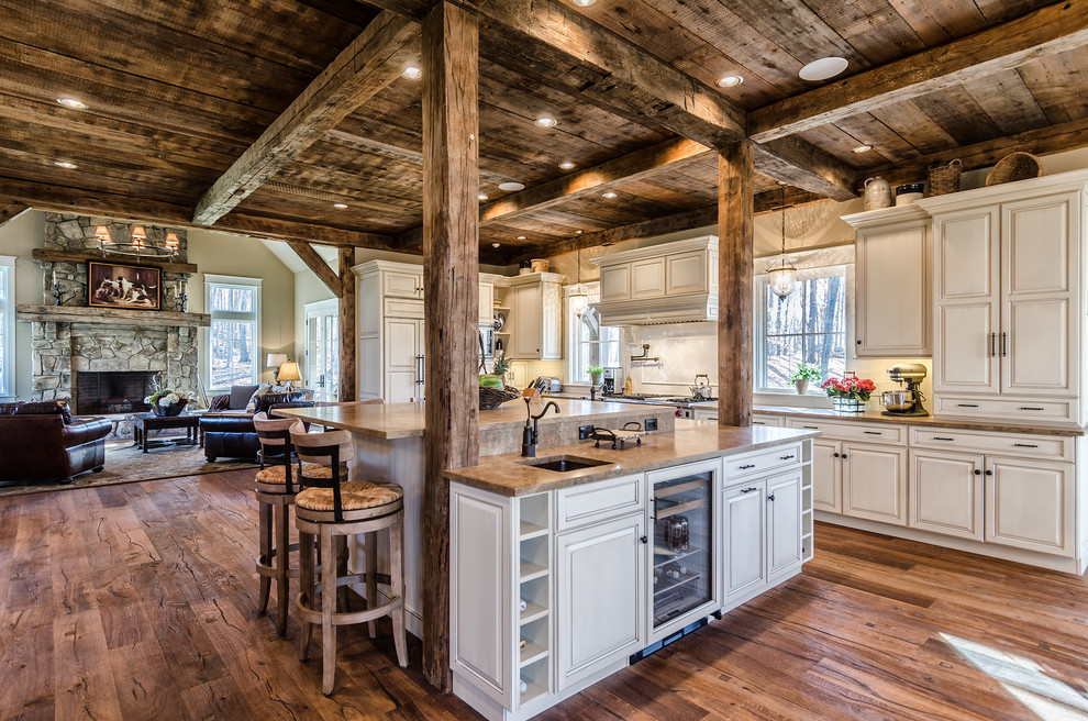 wood-ceiling-beams-wood-floor-stone-fireplace-marble-panels-recessed-white-rustic-home-furniture-kitchen