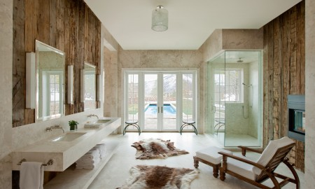 wood-wall-animal-fur-chaise-lounge-frankzosische-window-marble-shower-fireplace-opulent-and-rustic-bathroom-ideas