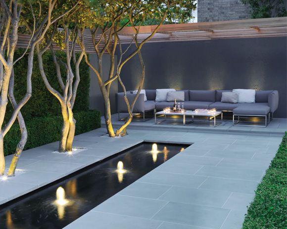 Fountain in the garden landscape in the minimalist style
