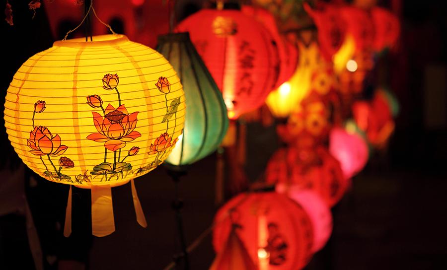 Illuminated lanterns decorated with paper lanterns