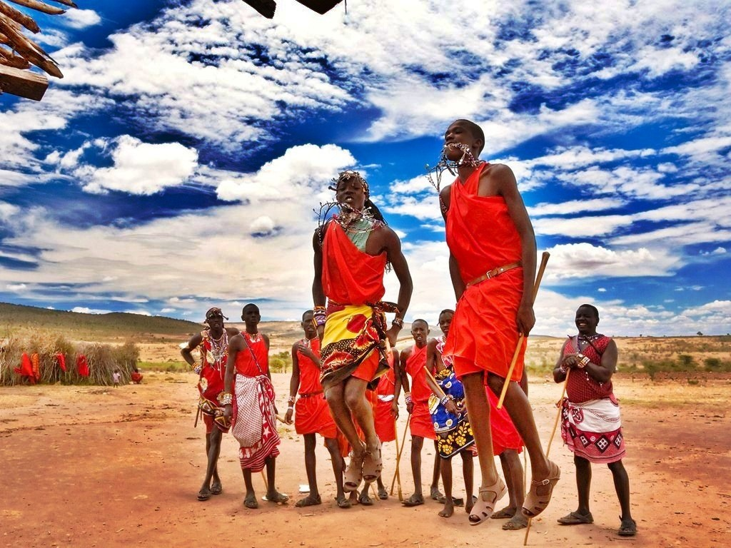 Masai family jumping Kenya landscape Colorful Clothes Masai Tribe