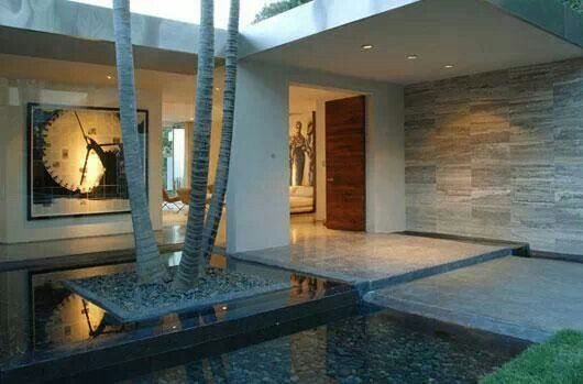 The water system in the entrance area landscape in the minimalist style