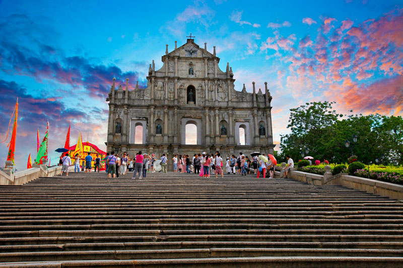 Ruins-Of-Saint-Pauls-Cathedral-Macau-China-Sunshine-Pink-clouds-Tourists-UNESCO