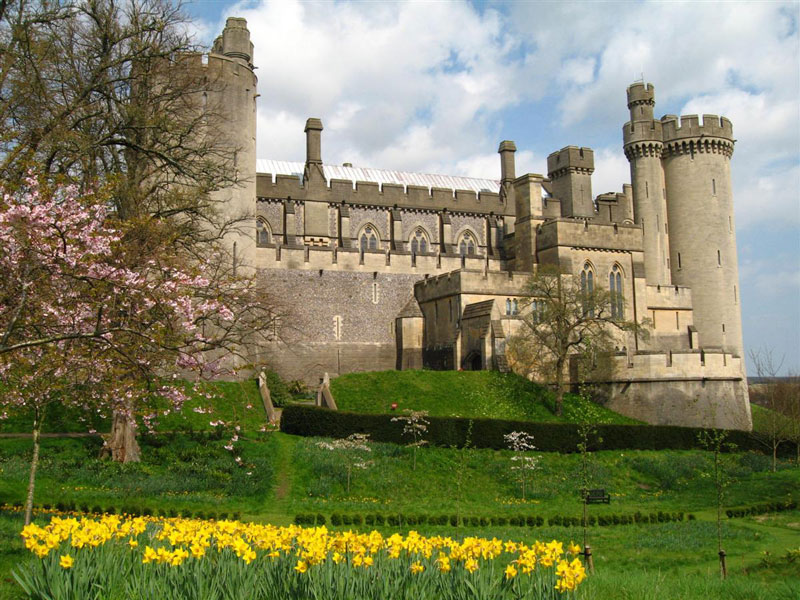 Amberley-Castle,-England-front-view-west-sussex-lovely-palace-green-grass-flowers