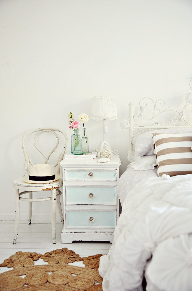 Bed headboard decorated metal chest of drawers chair wood flowers carpet white -Shabby chic furnishings