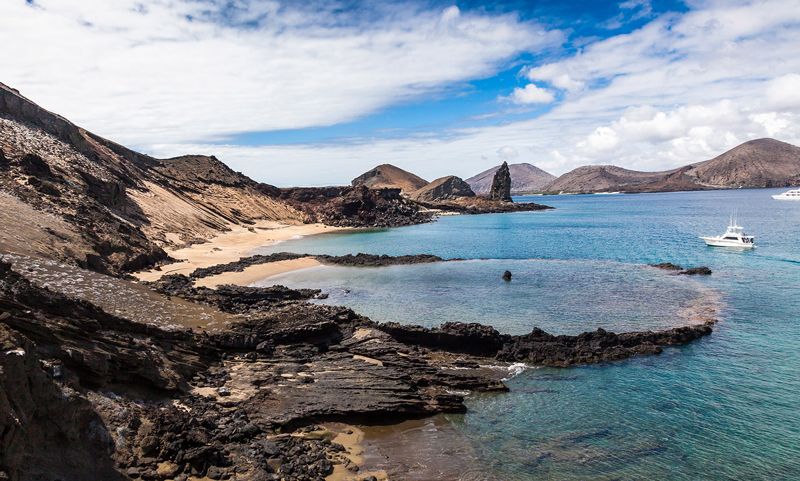 Galapagos-island-beach-seaside-boat-blue-water-beautiful-island