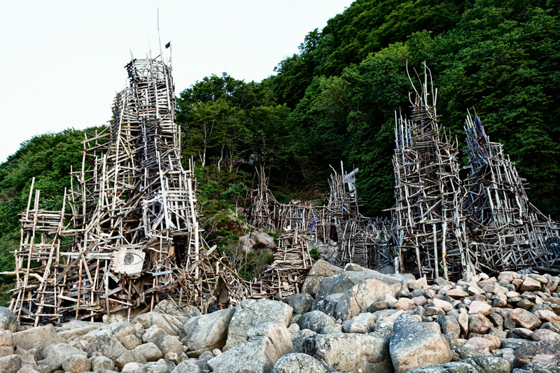 Most-Famous-micronations-Ladonia-wooden-buildings-wooden-tower-flag-island-country