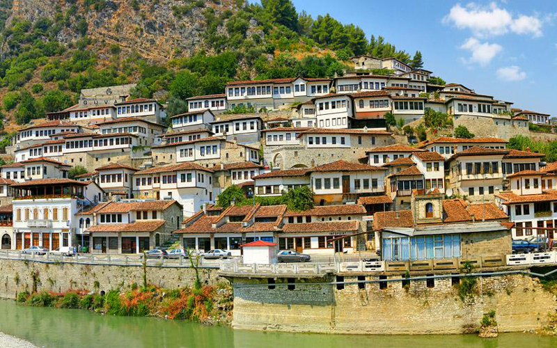 Shqipëria-Albanian-traditional-houses-near-road-beautiful-landscape-river-in-albania