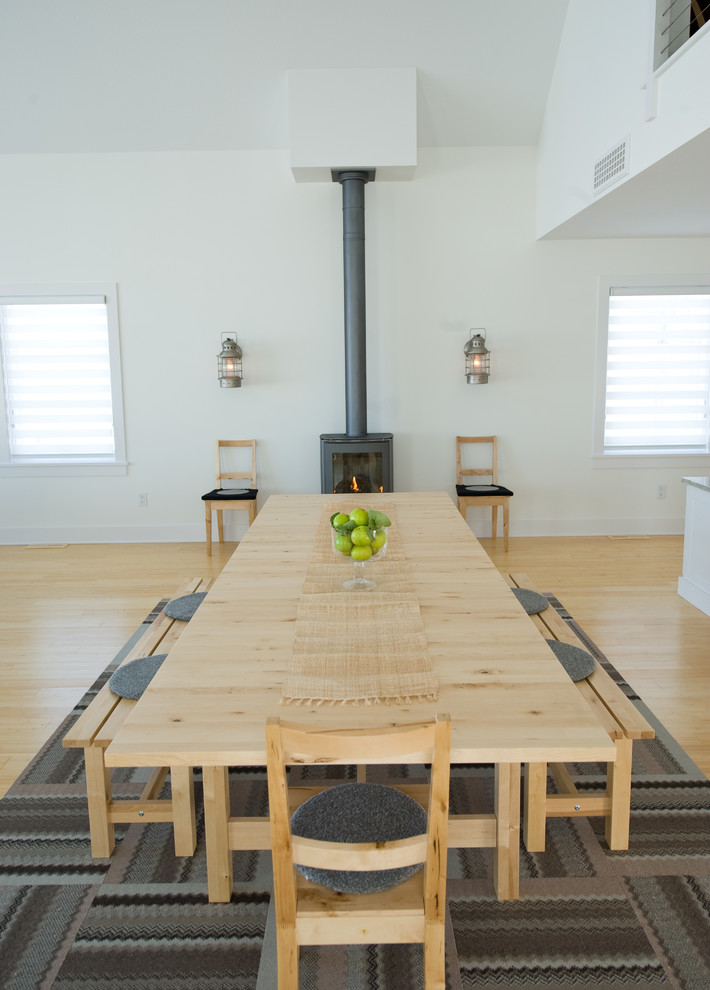 Bright dining room with wood stove-dining Tables